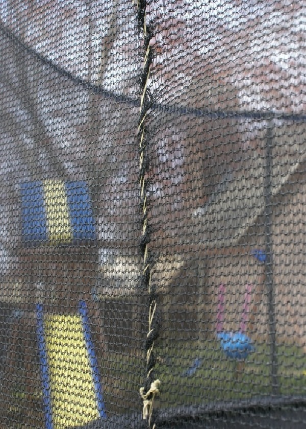 sewing up a trampoline net hole