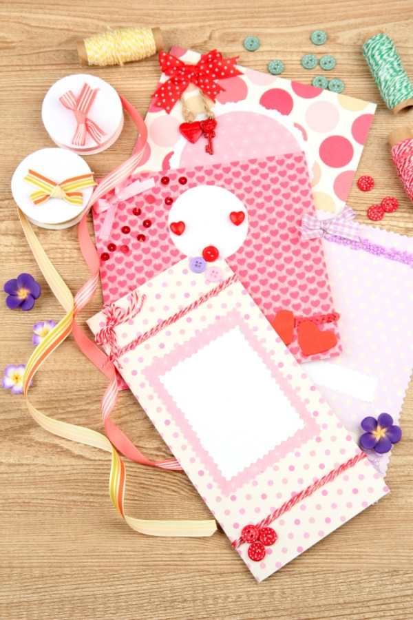 handmade cards and supplies on a table