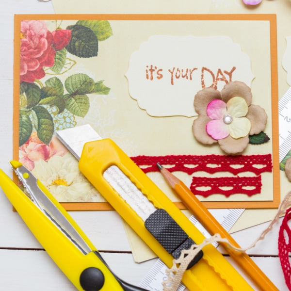 homemade card with tools and supplies on table