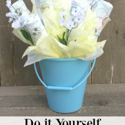 Learn how to make a diaper bouquet for your next baby shower! Using a pail is a great way to make diaper bouquet centerpieces for the tables at the shower!