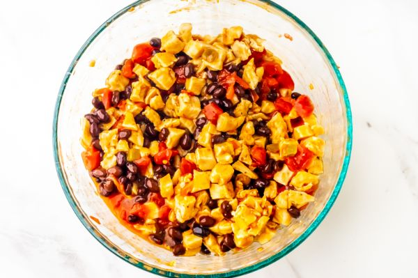 filling mixture in a bowl for Weight Watchers chicken Enchilada Bake