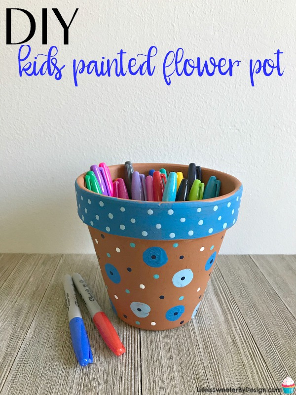 DIY kids painted flower pot project is a simple kids craft that makes a pretty painted clay flower pot. This is a great gift idea for end of the year teacher gifts or even Mother's Day gifts.