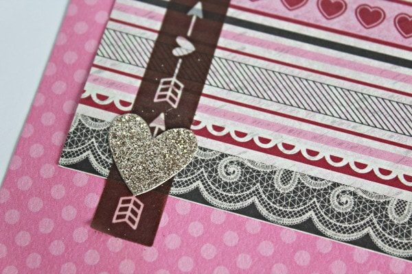 embellishments for a Valentine's Day scrapbook layout