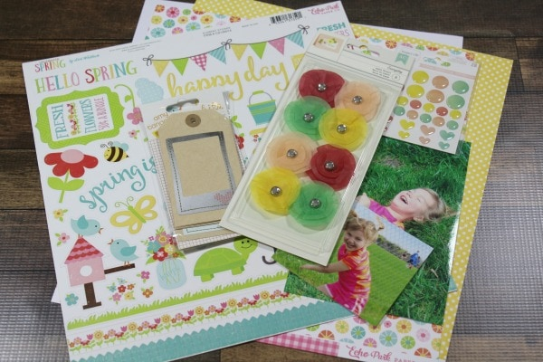 supplies for a spring scrapbook layout