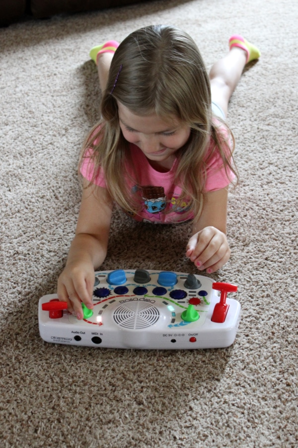 child playing a musical toy blipblox