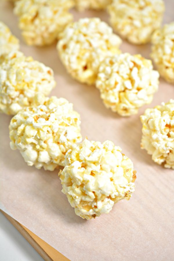 easy steps to make Ghost Halloween Popcorn Balls