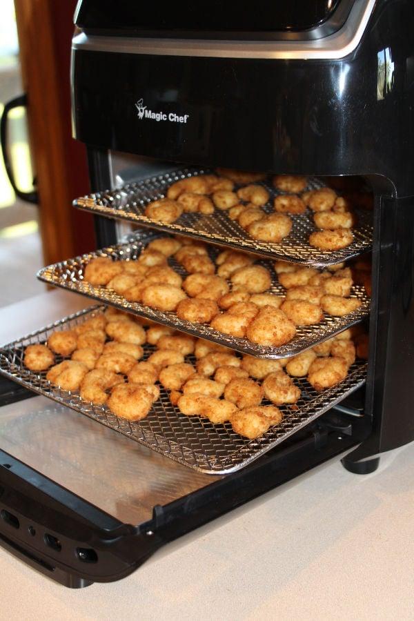 Magic Chef Air Fryer oven with popcorn shrimp on racks