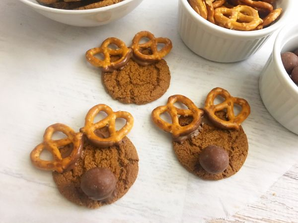 attaching antlers to gingersnap reindeer cookies