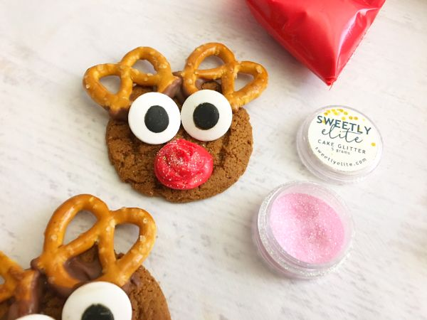 making a red nose on Reindeer Gingersnap Cookies