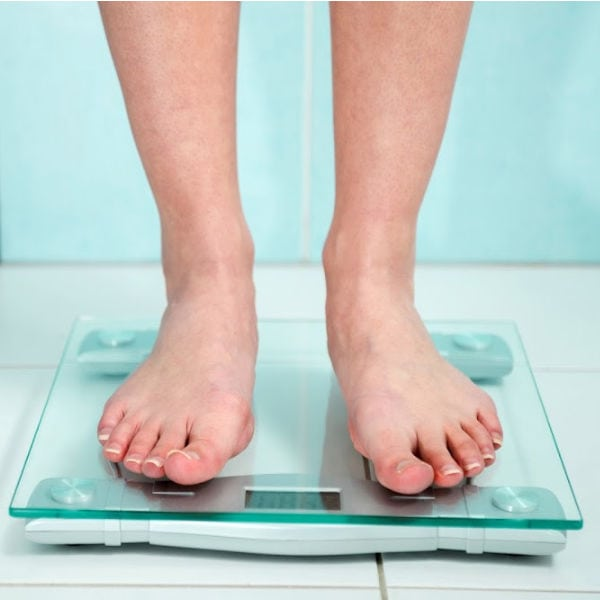 someone standing on bathroom scale