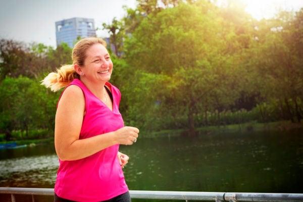 woman jogging in pink shirt