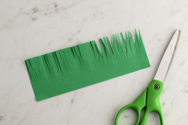 cutting grass out of green construction paper