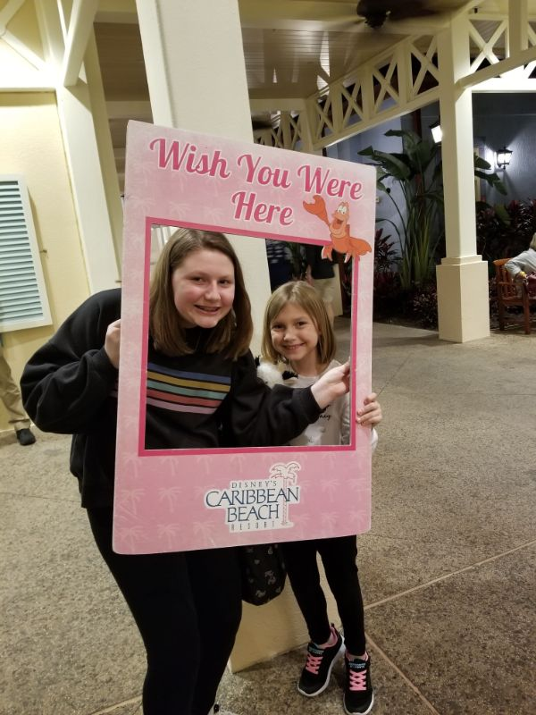 Disney Caribbean Beach Resort girls holding sign
