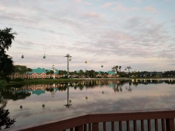 Disney Caribbean Beach Resort lake with skyliners going overhead