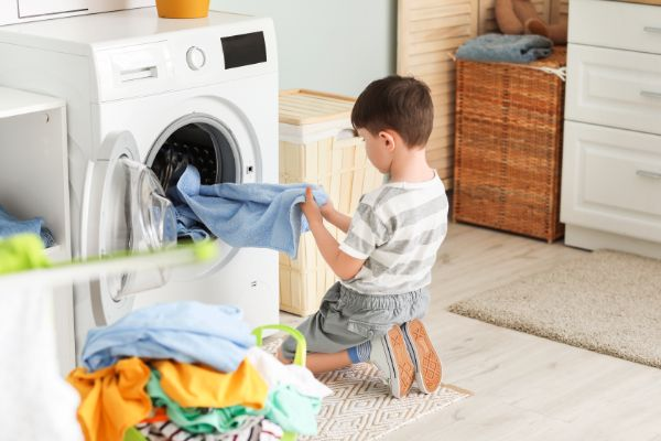 boy doing laundry