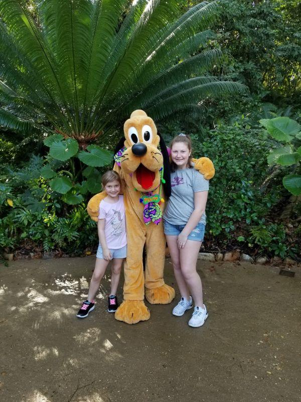 two kids hugging Pluto
