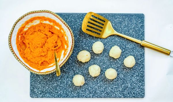 rolling dough for Air Fryer Pumpkin Dessert Balls
