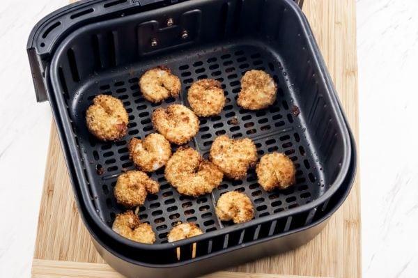 cooked breaded shrimp in air fryer basket