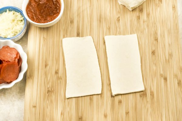 cutting dough for homemade pizza pockets in the air fryer