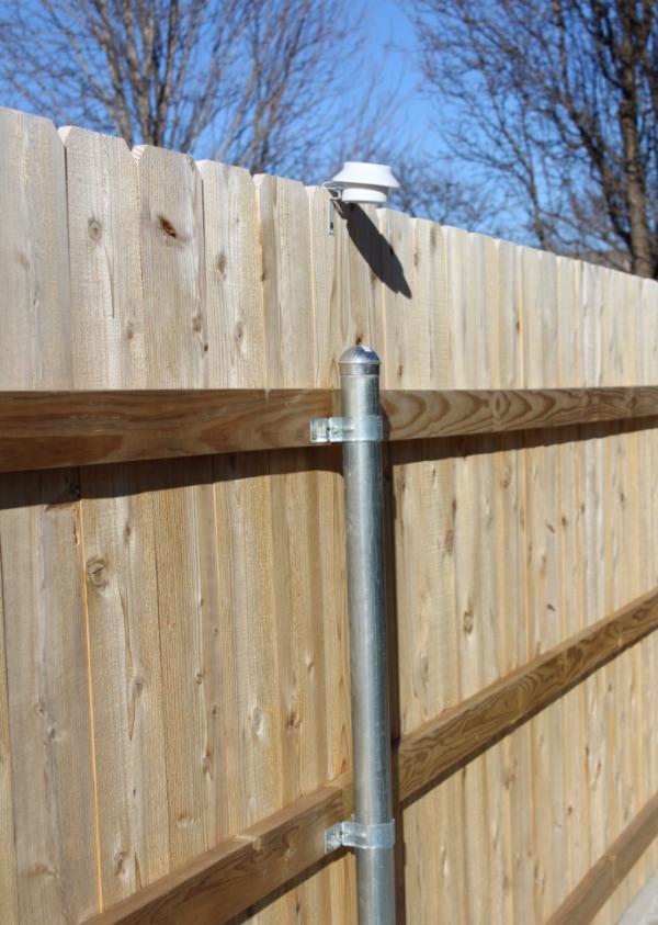 solar lights hanging on fence