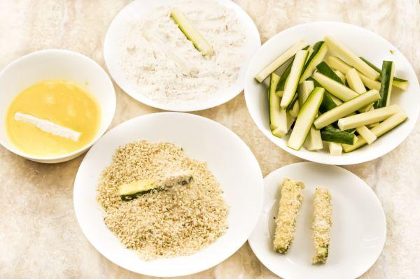 dredging zucchini sticks for zucchini fries