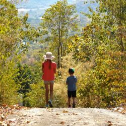 two children walking in nature