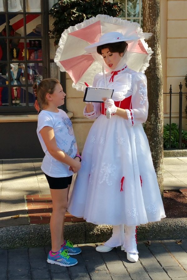 girl getting an autograph from Mary Poppins at Epcot