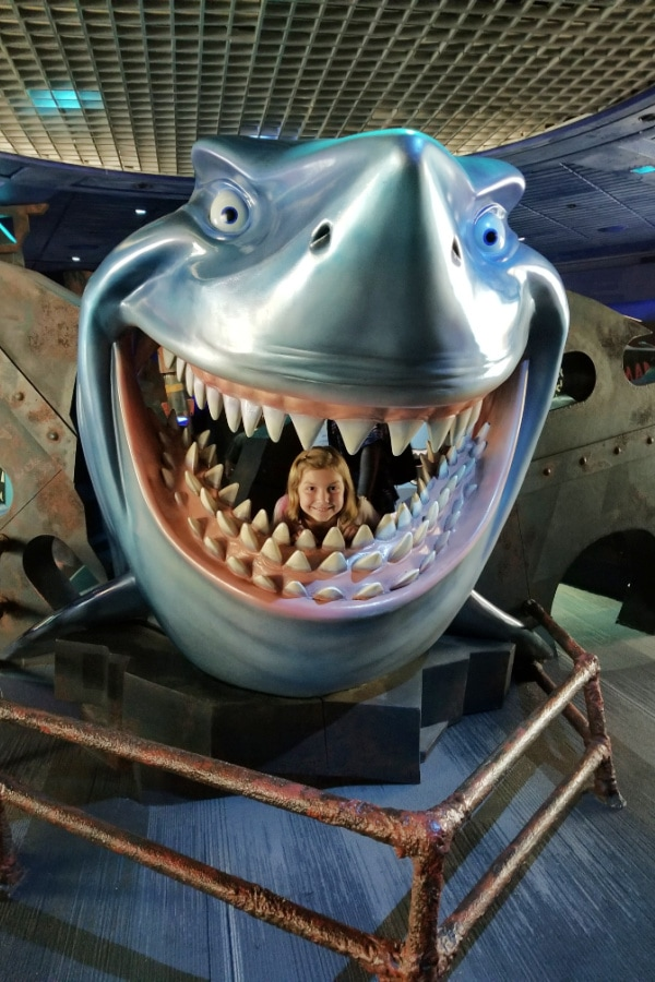 child inside fake shark at Epcot