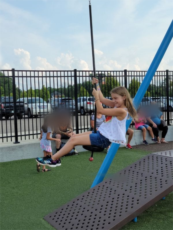 girl on a zip line at the playground of the Creation Museum